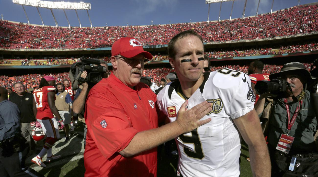 Kansas City Chiefs head coach Andy Reid, left, meets with New Orleans Saints quarterback Drew Brees (9) following an NFL football game in Kansas City, Mo., Sunday, Oct. 23, 2016. (AP Photo/Colin E. Braley)