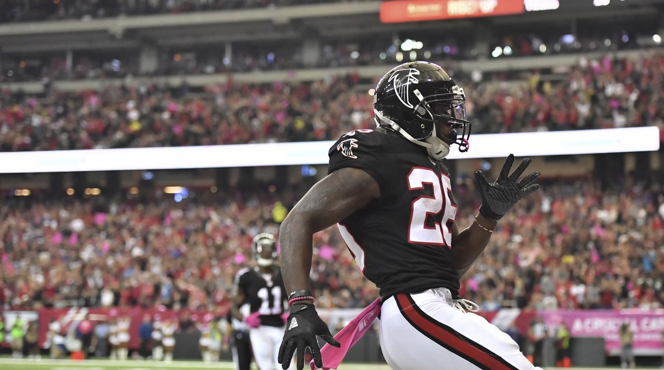 Atlanta Falcons running back Tevin Coleman (26) runs into the end zone for a touchdown against the San Diego Chargers during the first half of an NFL football game between the Atlanta Falcons and the San Diego Chargers, Sunday, Oct. 23, 2016, in Atlanta.