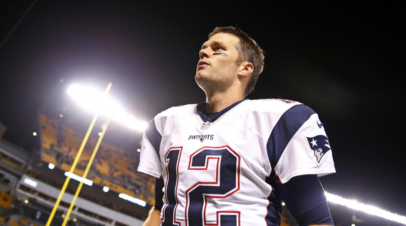 New England Patriots quarterback Tom Brady (12) heads to the locker room after a 27-16 win over the Pittsburgh Steelers in an NFL football game in Pittsburgh, Sunday, Oct. 23, 2016. (AP Photo/Jared Wickerham)