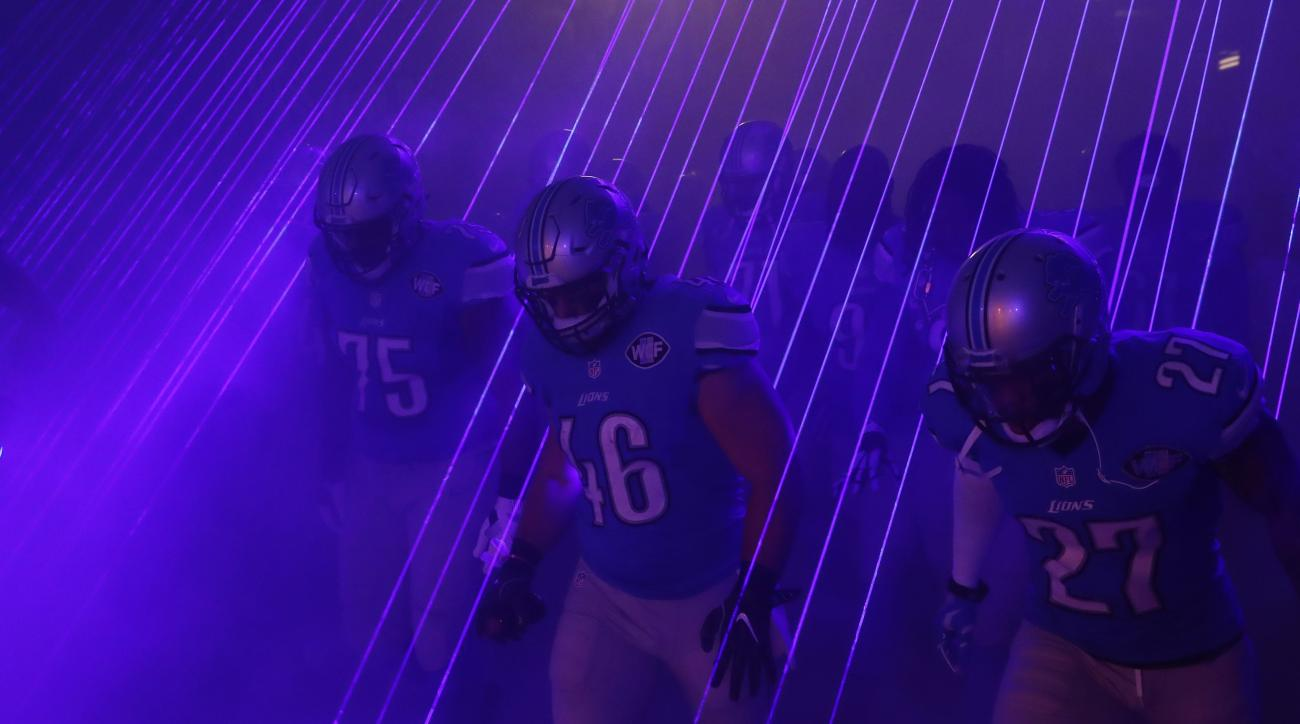 The Detroit Lions run onto the field during introductions before an NFL football game against the Washington Redskins, Sunday, Oct. 23, 2016 in Detroit. (AP Photo/Paul Sancya)