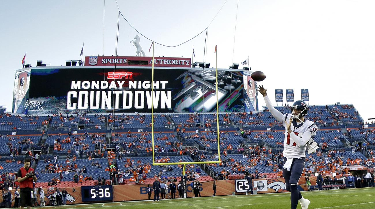 Houston Texans quarterback Brock Osweiler (17) warms up prior to an NFL football game against the Denver Broncos, Monday, Oct. 24, 2016, in Denver. (AP Photo/Jack Dempsey)