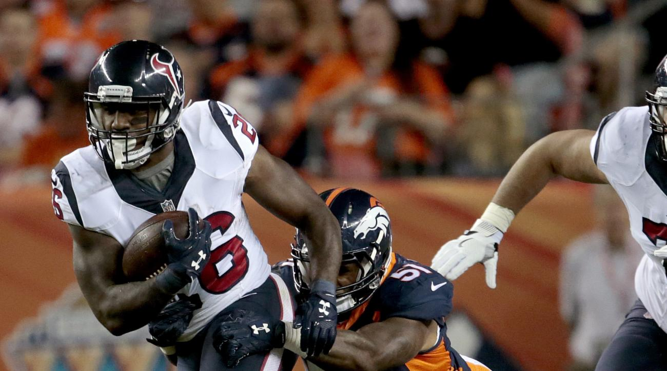Houston Texans running back Lamar Miller (26) is tackled by Denver Broncos inside linebacker Todd Davis (51) during the first half of an NFL football game, Monday, Oct. 24, 2016, in Denver. (AP Photo/Joe Mahoney)
