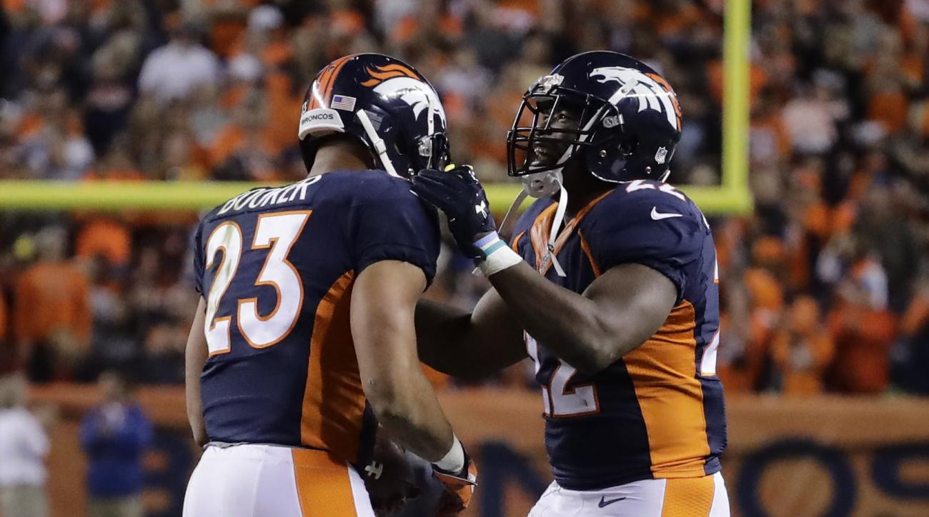 Denver Broncos running back Devontae Booker (23) celebrates his touchdown run with C.J. Anderson (22) during the second half of an NFL football game against the Houston Texans, Monday, Oct. 24, 2016, in Denver. (AP Photo/Jack Dempsey)