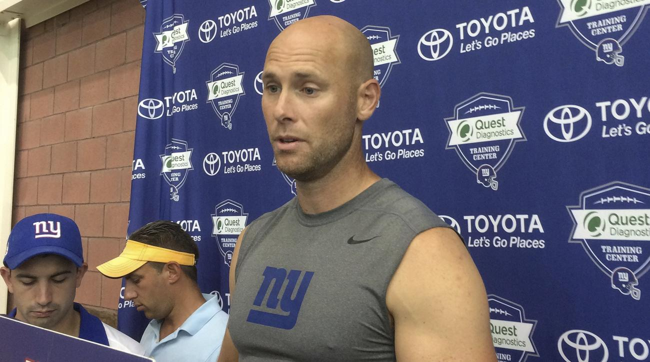 FILE - In this Aug. 18, 2016, file photo, New York Giants kicker Josh Brown speaks with reporters at NFL football training camp, in East Rutherford, N.J. The Giants have released placekicker Josh Brown after police documents revealed Brown had admitted to