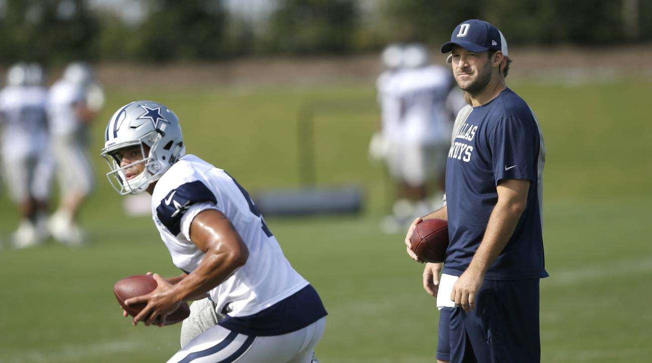 Dallas Cowboys quarterback Tony Romo looks on as fellow quarterback Dak Prescott runs a drill during NFL football practice at the team's practice facility in Frisco, Texas, Wednesday, Oct. 26, 2016. (AP Photo/LM Otero)