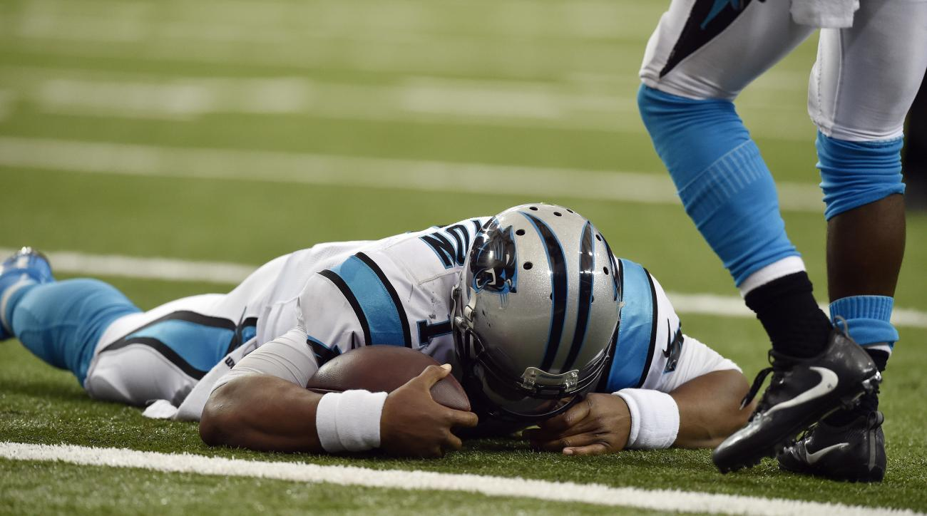 FILE - In this Oct. 2, 2016, file photo, Carolina Panthers quarterback Cam Newton (1) lies on the turf after a hit during a two-point conversion against the Atlanta Falcons in the second half of an NFL football game in Atlanta. Newton said his first concu