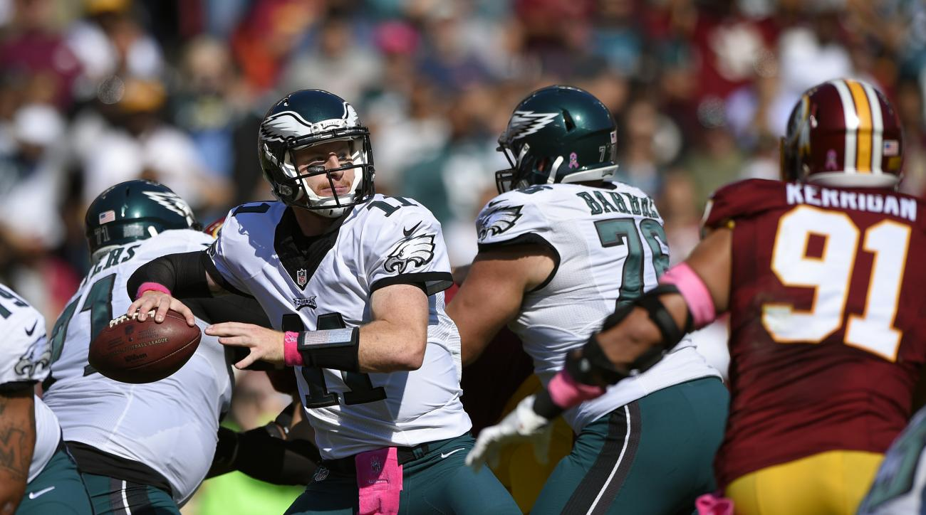 FILE - In this Sunday, Oct. 16, 2016, file photo, Philadelphia Eagles quarterback Carson Wentz throws to a receiver in the first half of an NFL football game against the Washington Redskins in Landover, Md. Even if deals are few and far between during an