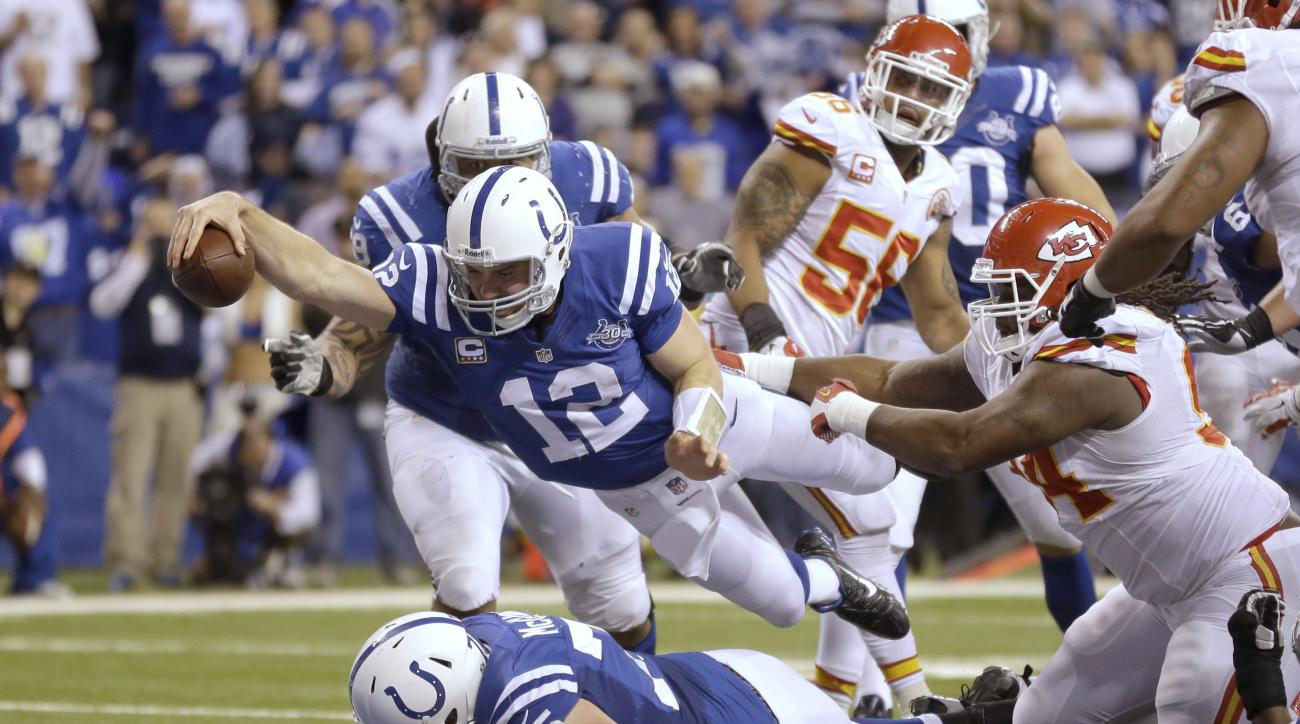 FILE - In this Jan. 4, 2014, file photo, Indianapolis Colts quarterback Andrew Luck (12) dives for a touchdown after recovering a fumble by the Colts' Eric Berry during the second half of an NFL wild-card playoff football game against the Kansas City Chie