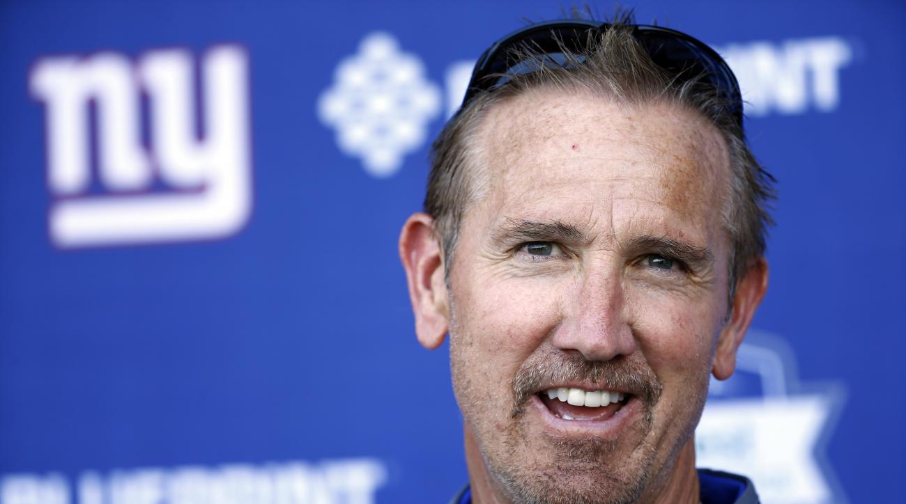FILE - In this June 15, 2016, file photo, New York Giants defensive coordinator Steve Spagnuolo talks to reporters during the NFL football team's minicamp in East Rutherford, N.J. The days of the Giants defense giving away games is seemingly over. A multi