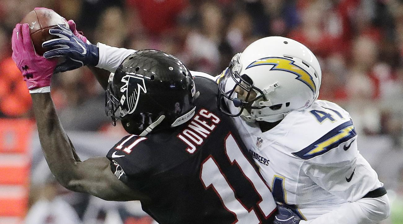 FILE - In this Oct. 23, 2016, file photo, Atlanta Falcons wide receiver Julio Jones (11) makes a catch as San Diego Chargers cornerback Steve Williams (41) defends during the first half of an NFL football game in Atlanta. Julio Jones leads the Falcons wit