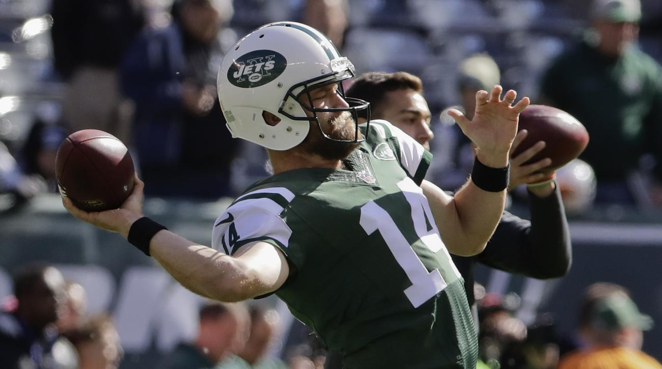 FILE - In this Oct. 23, 2016, file photo, New York Jets quarterback Ryan Fitzpatrick (14) warms up before an NFL football game against the Baltimore Ravens, in East Rutherford, N.J. Fantasy owners looking for QB help this week seem to be taking to Jets pa