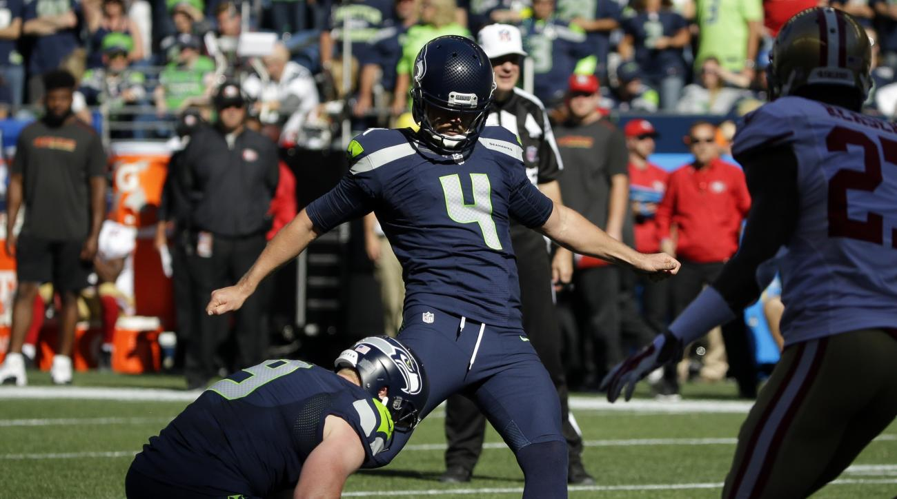 FILE - In this Sept. 25, 2016, file photo, Seattle Seahawks' Steven Hauschka (4) kicks a field goal as Jon Ryan holds against the San Francisco 49ers in the second half of an NFL football game in Seattle. Hauschka pulled a 28-yard attempt wide left during