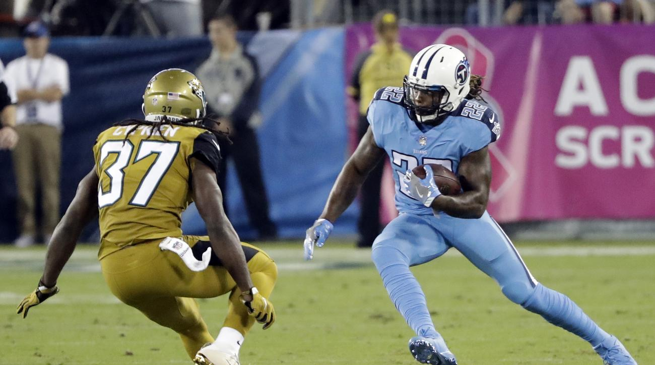 Tennessee Titans running back Derrick Henry (22) tries to get past Jacksonville Jaguars safety Johnathan Cyprien (37) in the first half of an NFL football game Thursday, Oct. 27, 2016, in Nashville, Tenn. (AP Photo/James Kenney)