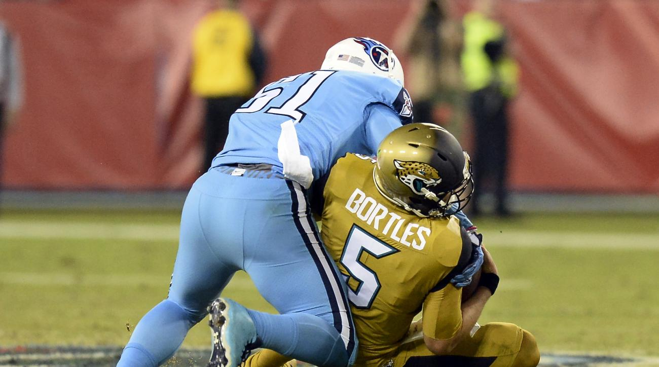 Jacksonville Jaguars quarterback Blake Bortles (5) is brought down by Tennessee Titans outside linebacker David Bass (51) in the first half of an NFL football game Thursday, Oct. 27, 2016, in Nashville, Tenn. (AP Photo/Mark Zaleski)
