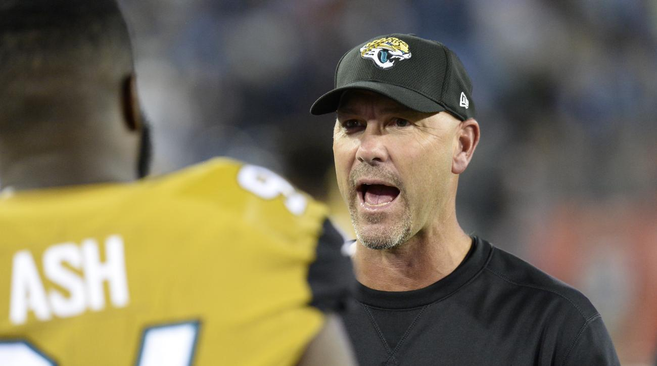 Jacksonville Jaguars head coach Gus Bradley talks to defensive tackle Richard Ash, left, in the second half of an NFL football game against the Tennessee Titans Thursday, Oct. 27, 2016, in Nashville, Tenn. (AP Photo/Mark Zaleski)