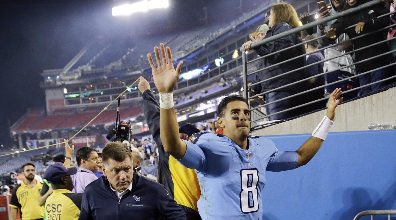 Tennessee Titans quarterback Marcus Mariota waves to fans as he leaves the field after an NFL football game against the Jacksonville Jaguars Thursday, Oct. 27, 2016, in Nashville, Tenn. The Titans won 36-22. (AP Photo/James Kenney)