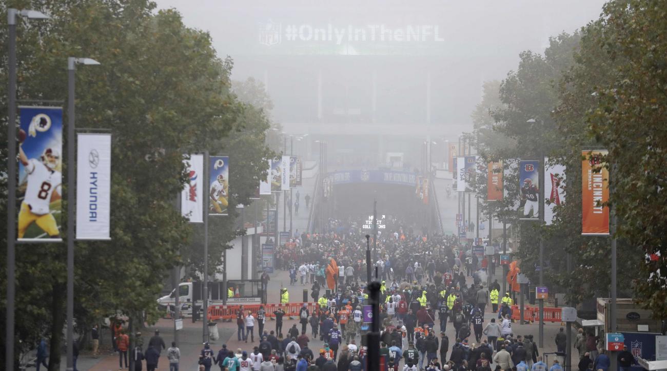 Fog shrouds Wembley Way as fans arrive for an NFL Football game between Washington Redskins and Cincinnati Bengals at Wembley Stadium in London, Sunday Oct. 30, 2016. (AP Photo/Matt Dunham)