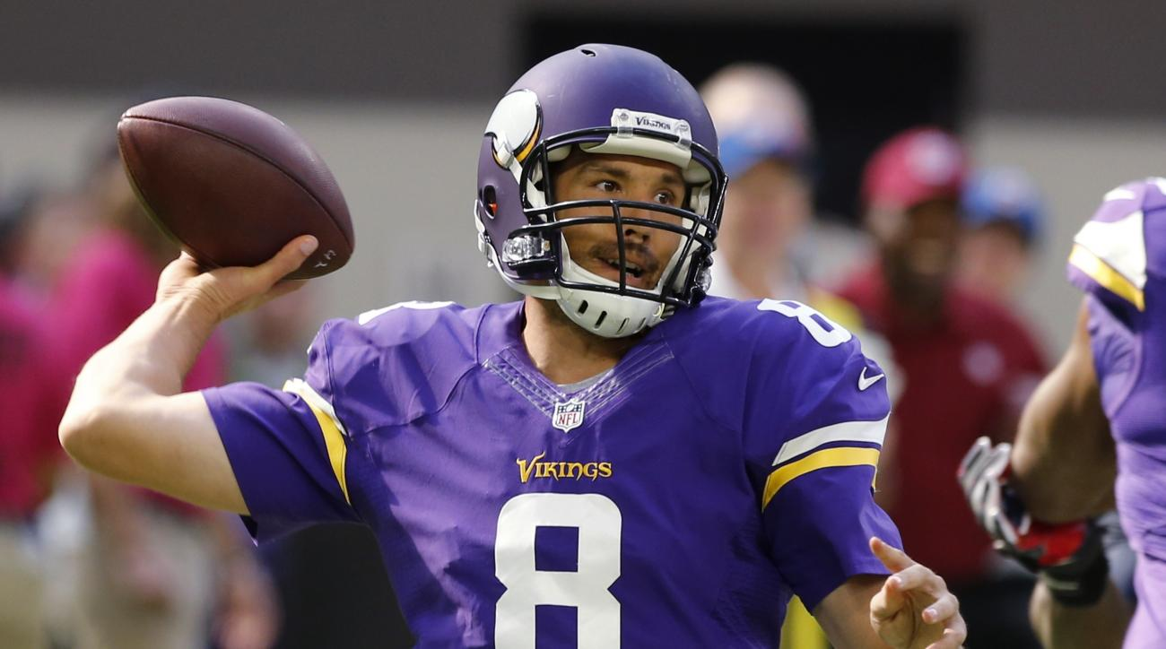 FILE - In this Oct. 9, 2016, file photo, Minnesota Vikings quarterback Sam Bradford throws a pass during the team's NFL football game against the Houston Texans in Minneapolis. The Vikings take on the Chicago Bears on Monday, Oct. 31, 2016. (AP Photo/Jim