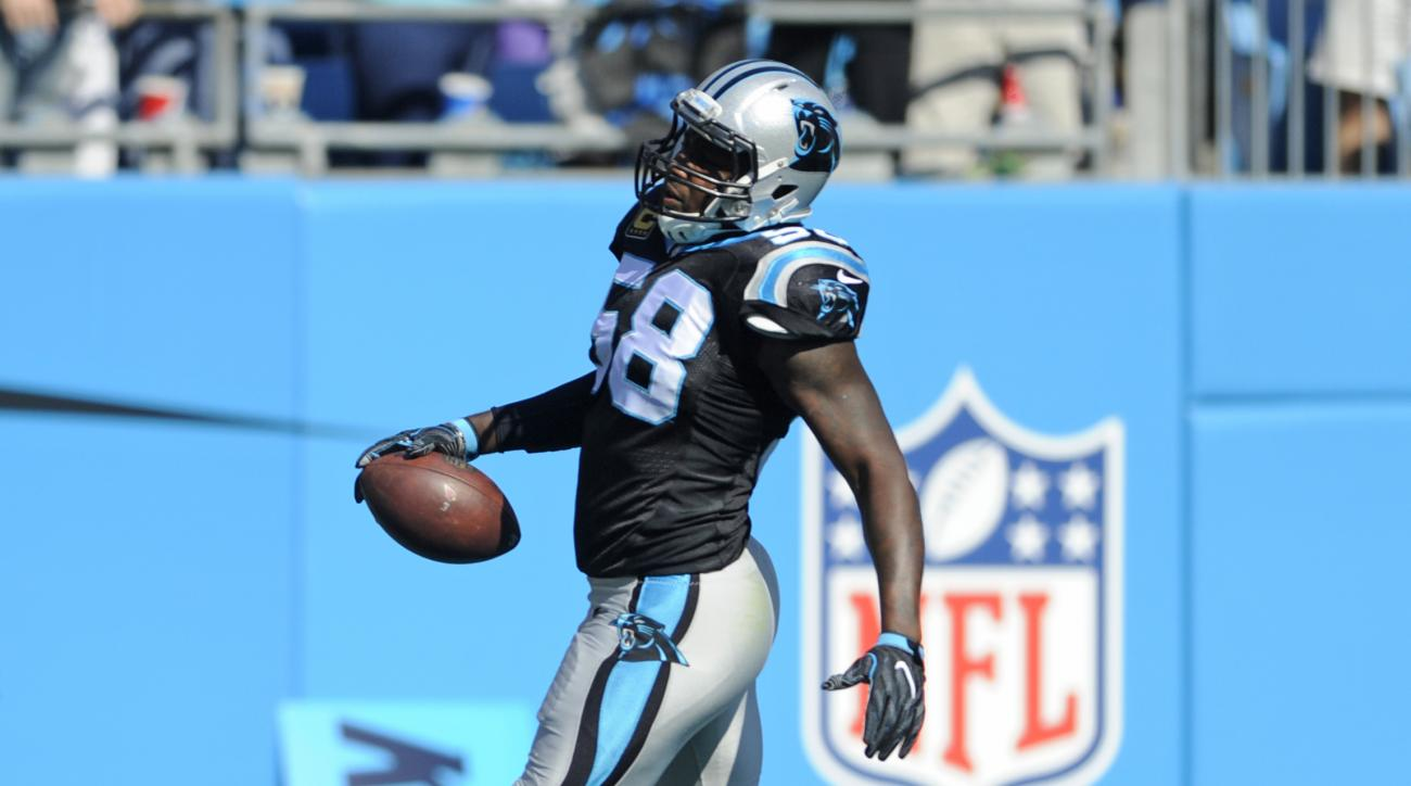 Carolina Panthers' Thomas Davis (58) returns an Arizona Cardinals fumble for a touchdown in the first quarter of an NFL football game in Charlotte, N.C., Sunday, Oct. 30, 2016. (AP Photo/Mike McCarn)