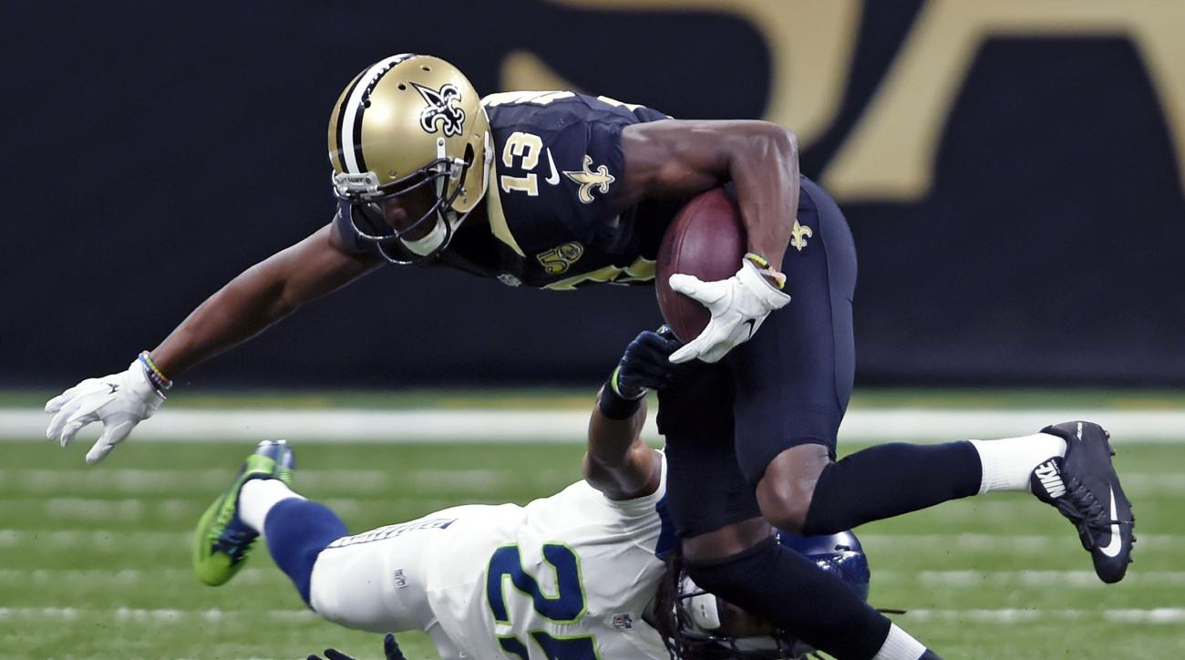 Seattle Seahawks cornerback Richard Sherman (25) tries to tackle New Orleans Saints wide receiver Michael Thomas (13) in the first half of an NFL football game in New Orleans, Sunday, Oct. 30, 2016. (AP Photo/Bill Feig)