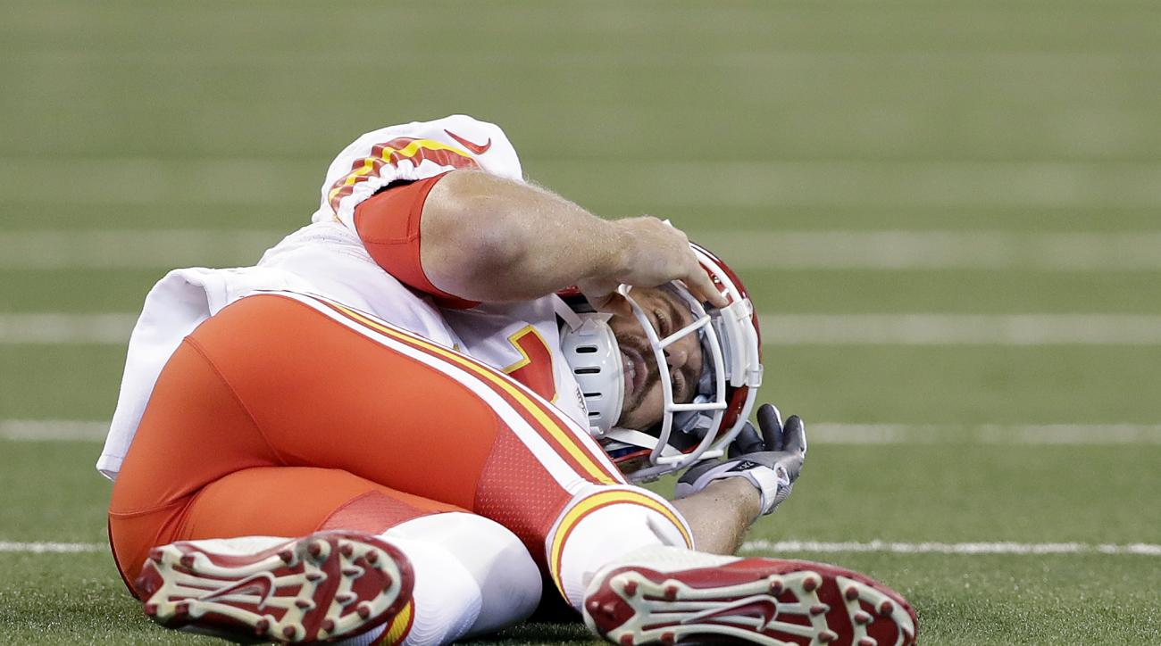 Kansas City Chiefs quarterback Alex Smith lays on the ground after getting tackled by Indianapolis Colts' Edwin Jackson during the first half of an NFL football game Sunday, Oct. 30, 2016, in Indianapolis. (AP Photo/Darron Cummings)