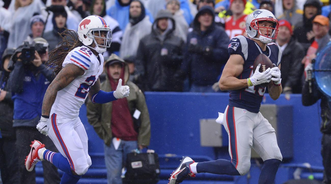 New England Patriots wide receiver Chris Hogan (15) runs away from Buffalo Bills' Stephon Gilmore (24) for a touchdown during the first half of an NFL football game Sunday, Oct. 30, 2016, in Orchard Park, N.Y. (AP Photo/Adrian Kraus)