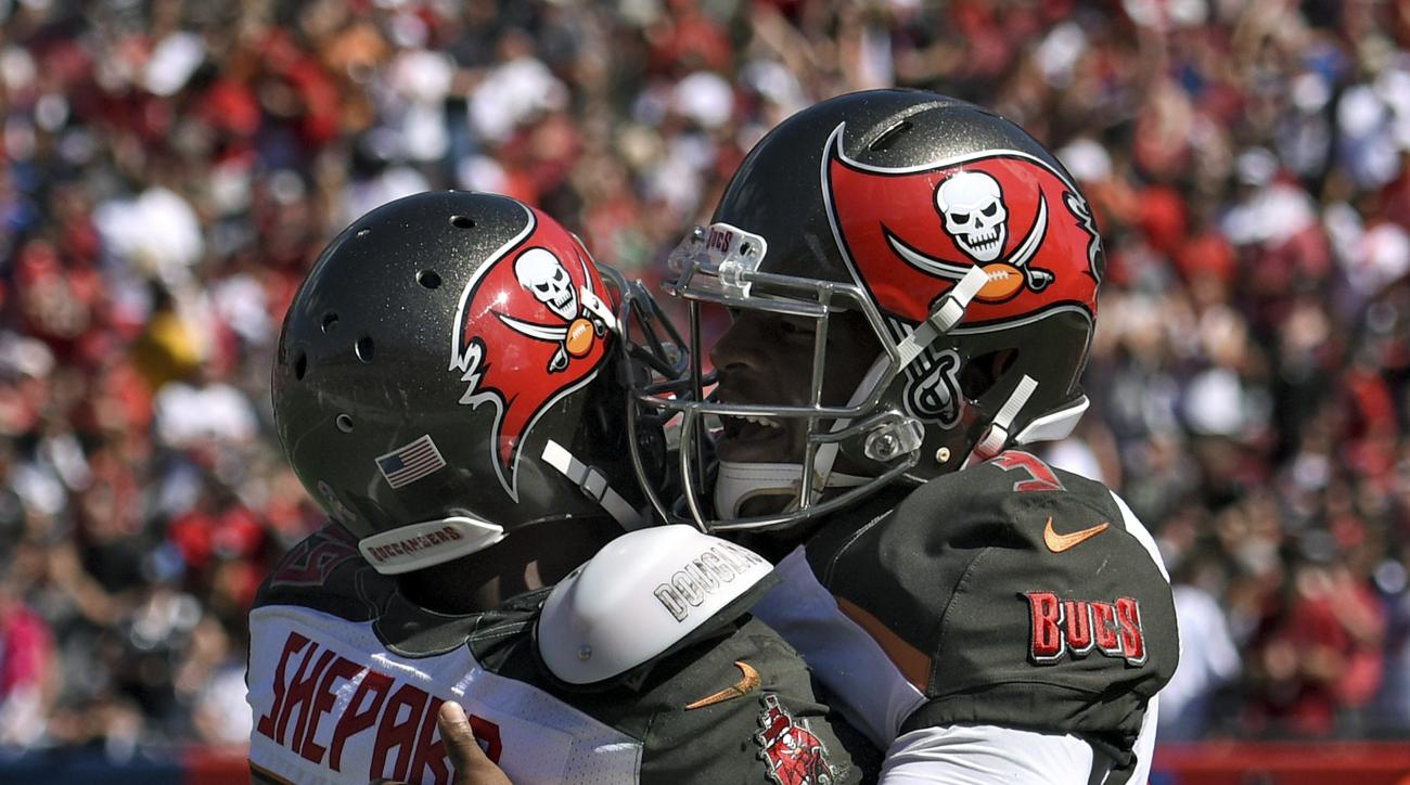 Tampa Bay Buccaneers wide receiver Russell Shepard (89) hugs quarterback Jameis Winston (3) after Shepard caught a 19-yard touchdown pass during the second quarter of an NFL football game against the Oakland Raiders Sunday, Oct. 30, 2016, in Tampa, Fla. (