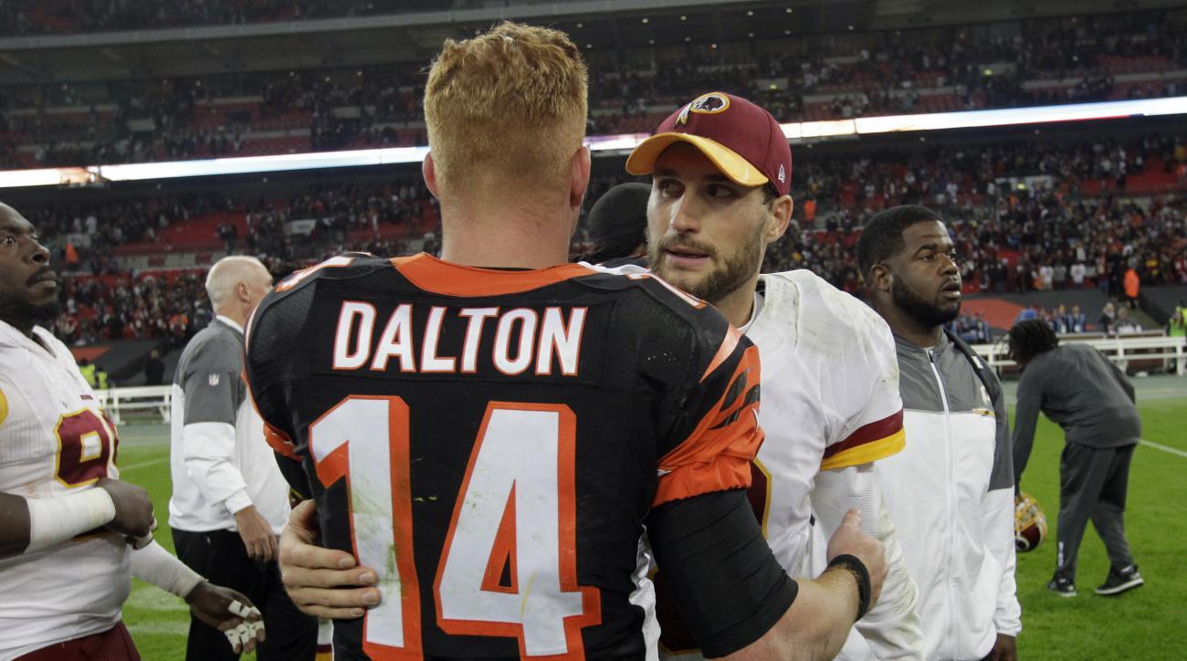 Washington Redskins quarterback Kirk Cousins (8) shakes hands with Cincinnati Bengals quarterback Andy Dalton (14) after an NFL Football game between Cincinnati Bengals and Washington Redskins at Wembley Stadium in London, Sunday Oct. 30, 2016. (AP Photo/