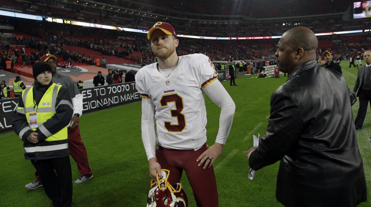 Washington Redskins kicker Dustin Hopkins (3) walks off the field after an NFL Football game between Cincinnati Bengals and Washington Redskins at Wembley Stadium in London, Sunday Oct. 30, 2016. (AP Photo/Tim Ireland)