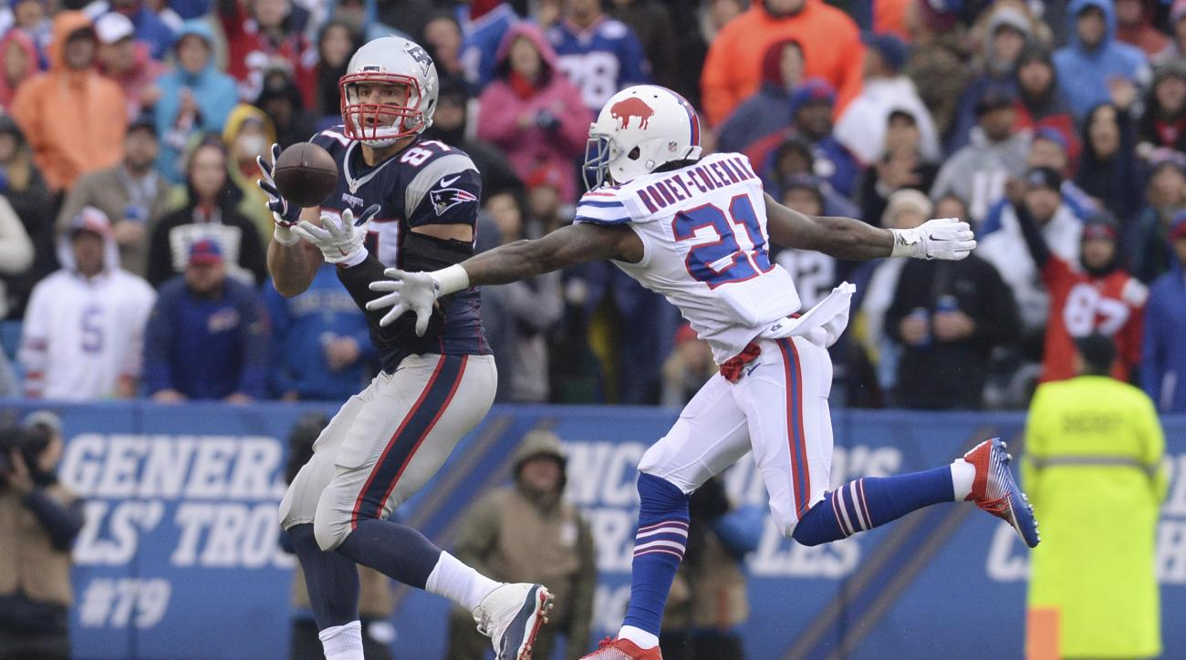 New England Patriots tight end Rob Gronkowski (87) catches a pass in front of Buffalo Bills' Nickell Robey-Coleman (21) during the first half of an NFL football game Sunday, Oct. 30, 2016, in Orchard Park, N.Y. Gronkowski scored a touchdown on the play. (