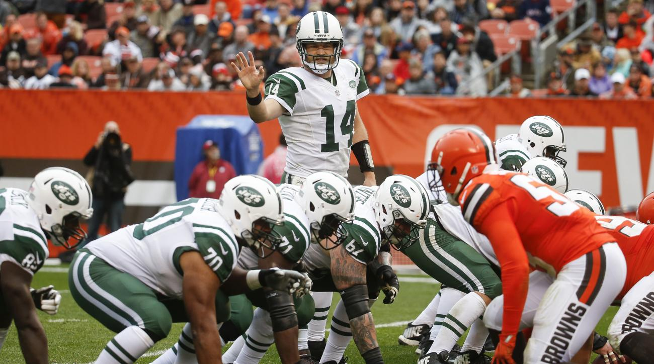 New York Jets quarterback Ryan Fitzpatrick (14) calls a play at the line of scrimmage in the second half of an NFL football game against the Cleveland Browns, Sunday, Oct. 30, 2016, in Cleveland. (AP Photo/Ron Schwane)
