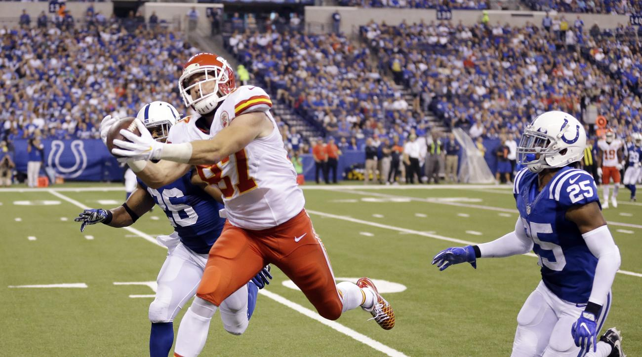 Kansas City Chiefs' Travis Kelce (87) tries to make a catch against Indianapolis Colts' Clayton Geathers (26) and Patrick Robinson (25) during the second half of an NFL football game Sunday, Oct. 30, 2016, in Indianapolis. The pass was ruled incomplete. (