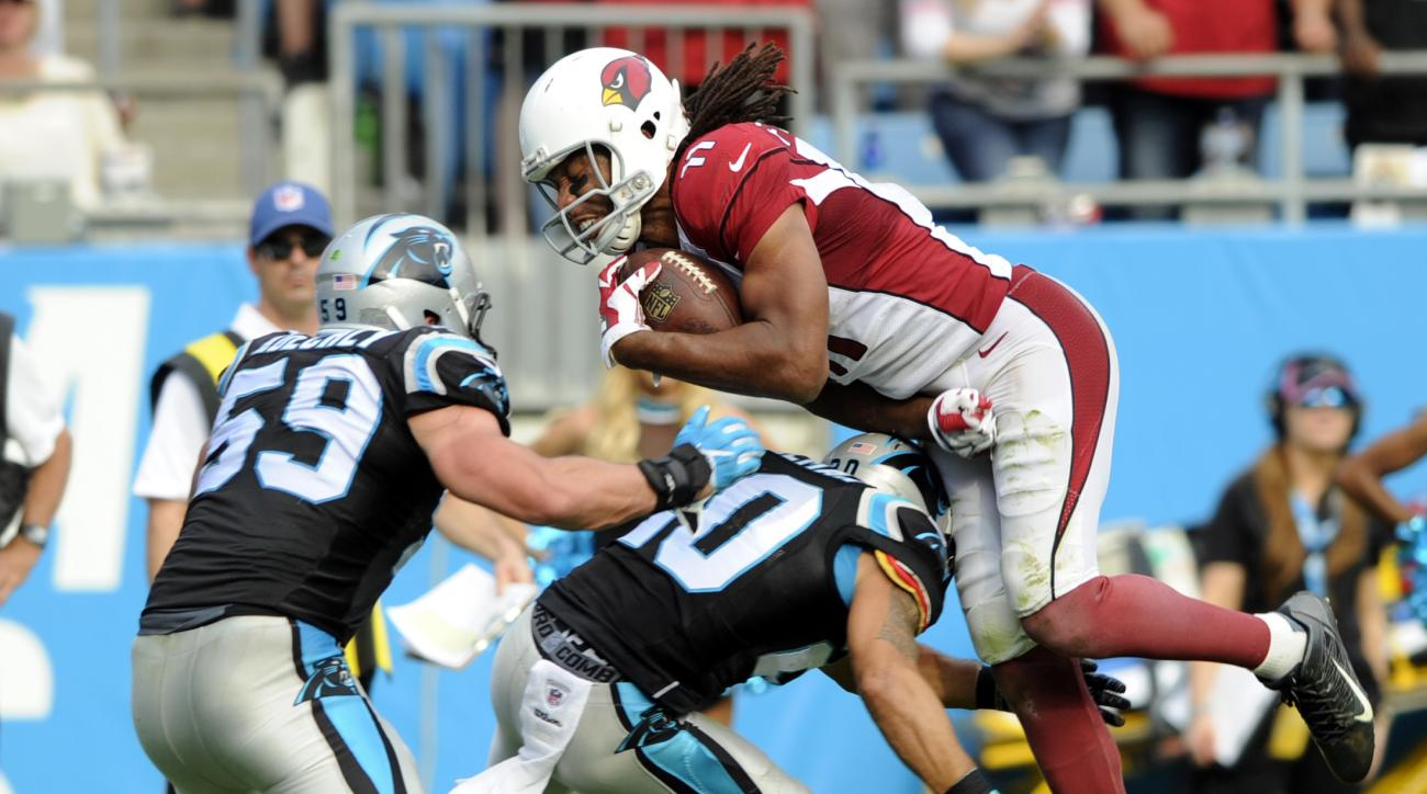 Arizona Cardinals' Larry Fitzgerald (11) is upended by Carolina Panthers' Kurt Coleman (20) in the second half of an NFL football game in Charlotte, N.C., Sunday, Oct. 30, 2016. (AP Photo/Mike McCarn)