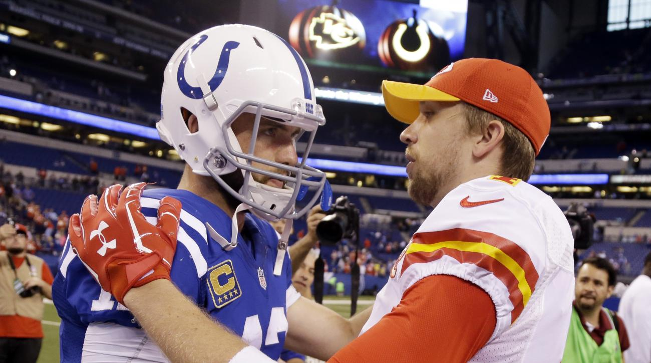 Kansas City Chiefs quarterback Nick Foles, right, talks with Indianapolis Colts quarterback Andrew Luck following of an NFL football game Sunday, Oct. 30, 2016, in Indianapolis. Kansas City won the game 30-14. (AP Photo/Michael Conroy)