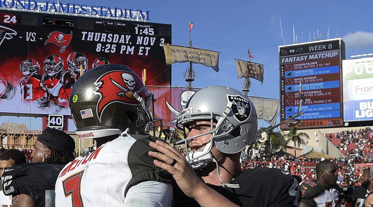 Tampa Bay Buccaneers quarterback Jameis Winston (3) congratulates Oakland Raiders quarterback Derek Carr (4) after the Raiders defeated the Tampa Bay Buccaneers 30-24 in overtime during an NFL football game Sunday, Oct. 30, 2016, in Tampa, Fla. (AP Photo/