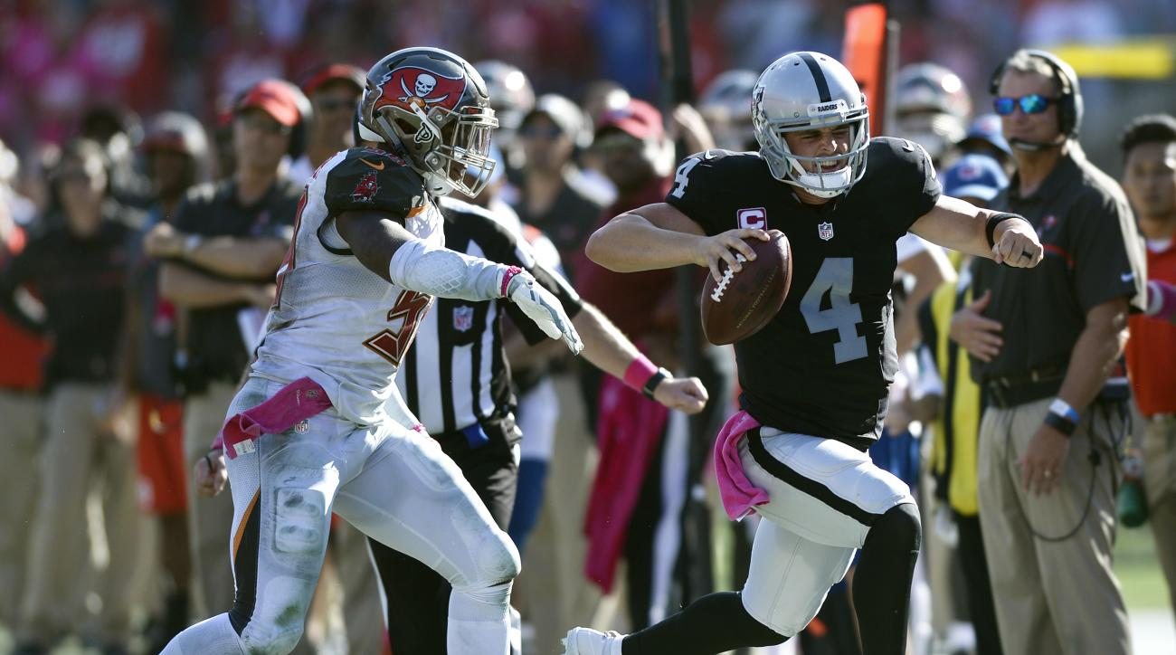 Oakland Raiders quarterback Derek Carr (4) is forced out of bounds by Tampa Bay Buccaneers middle linebacker Kwon Alexander (58) during overtime in an NFL football game Sunday, Oct. 30, 2016, in Tampa, Fla. The Raiders on the game 30-24. (AP Photo/Jason B