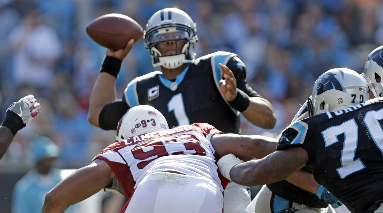 Arizona Cardinals' Calais Campbell (93) defends as Carolina Panthers' Cam Newton (1) looks to pass in the second half of an NFL football game in Charlotte, N.C., Sunday, Oct. 30, 2016. Campbell hit Newton after the throw, which Newton felt was an illegal