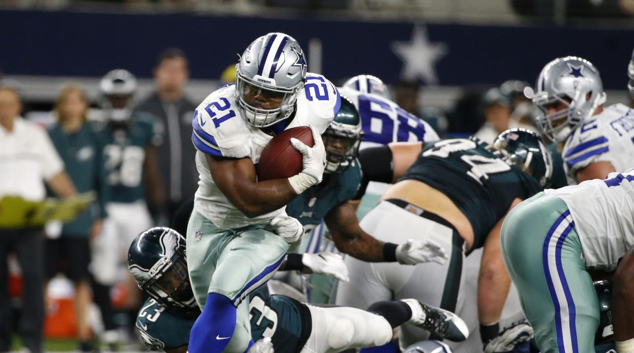 Dallas Cowboys running back Ezekiel Elliott (21) fights off a tackle attempt by Philadelphia Eagles free safety Rodney McLeod (23) as he gains yardage on a run in overtime of an NFL football game, Sunday, Oct. 30, 2016, in Arlington, Texas. (AP Photo/Mich