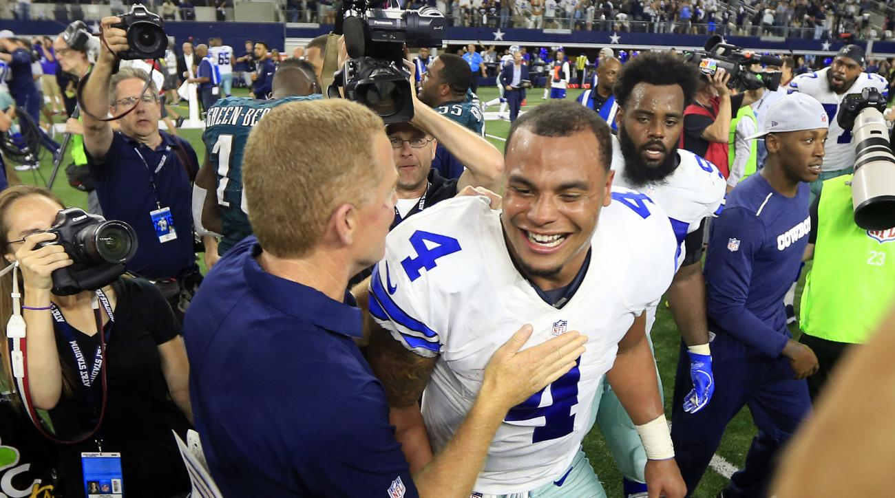 Dallas Cowboys head coach Jason Garrett and quarterback Dak Prescott (4) celebrate their overtime 29-23 overtime win against the Philadelphia Eagles in an NFL football game, Sunday, Oct. 30, 2016, in Arlington, Texas. (AP Photo/Ron Jenkins)