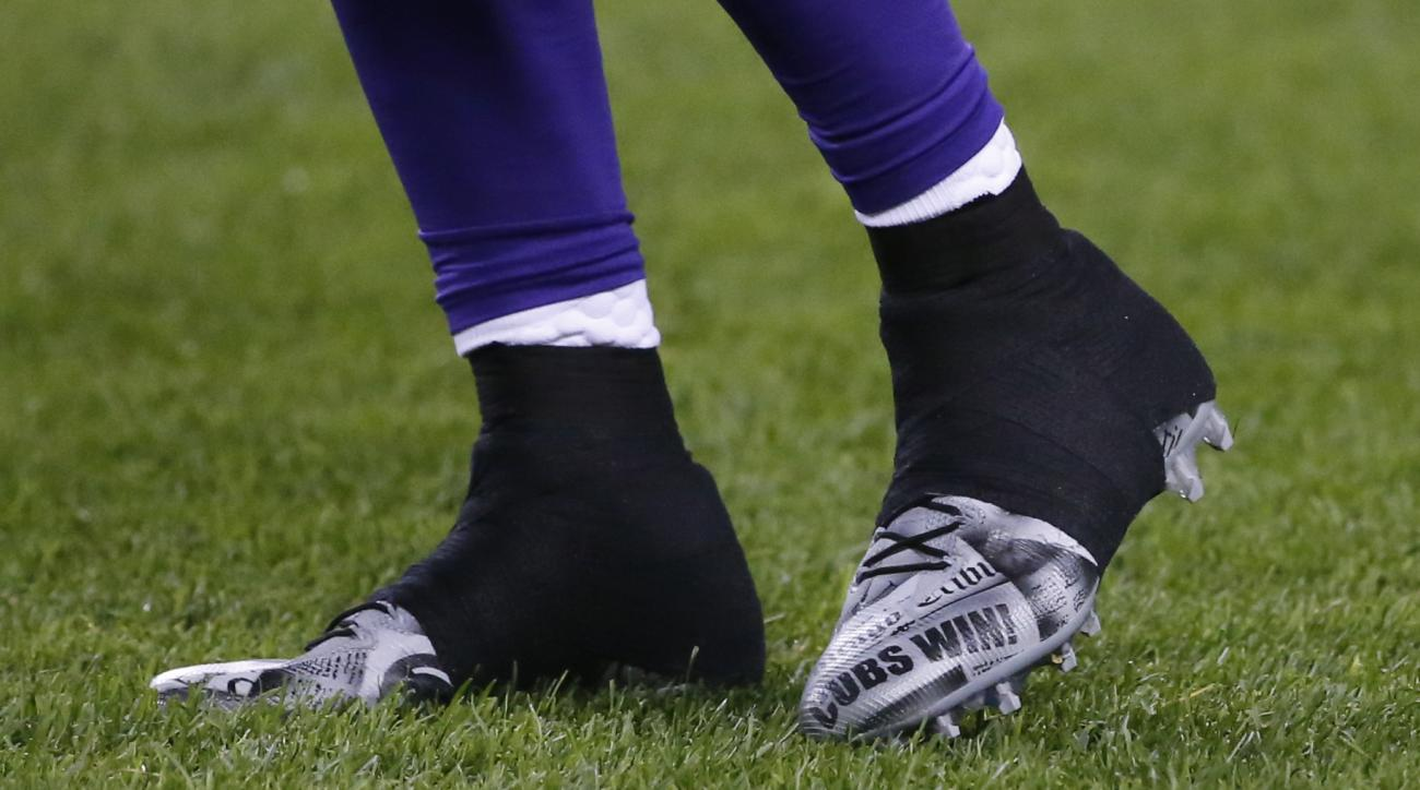 Minnesota Vikings wide receiver Laquon Treadwell's cleats are shown with Cubs Win! on them during warmups before an NFL football game against the Chicago Bears in Chicago, Monday, Oct. 31, 2016. The Cubs are playing the Cleveland Indians in the World Seri