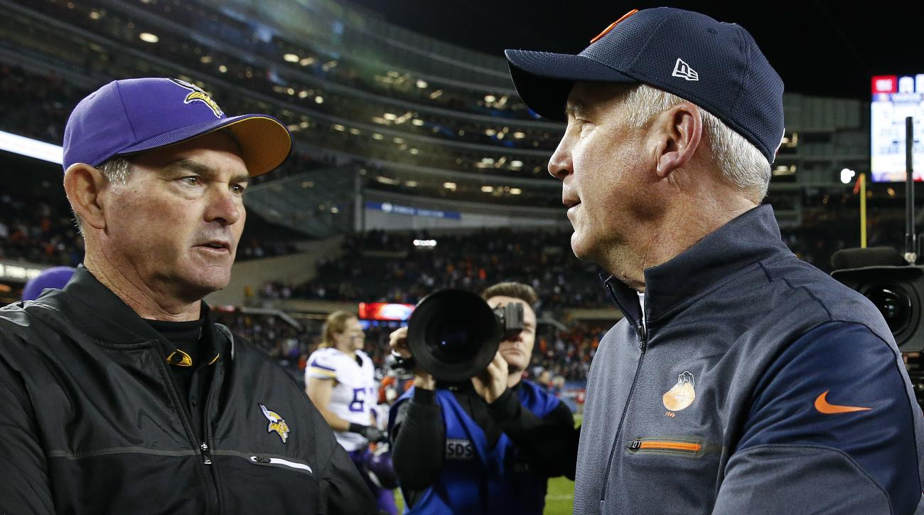 Minnesota Vikings head coach Mike Zimmer, left, and Chicago Bears head coach John Fox shake hands after an NFL football game in Chicago, Monday, Oct. 31, 2016. Chicago won 20-10. (AP Photo/Nam Y. Huh)