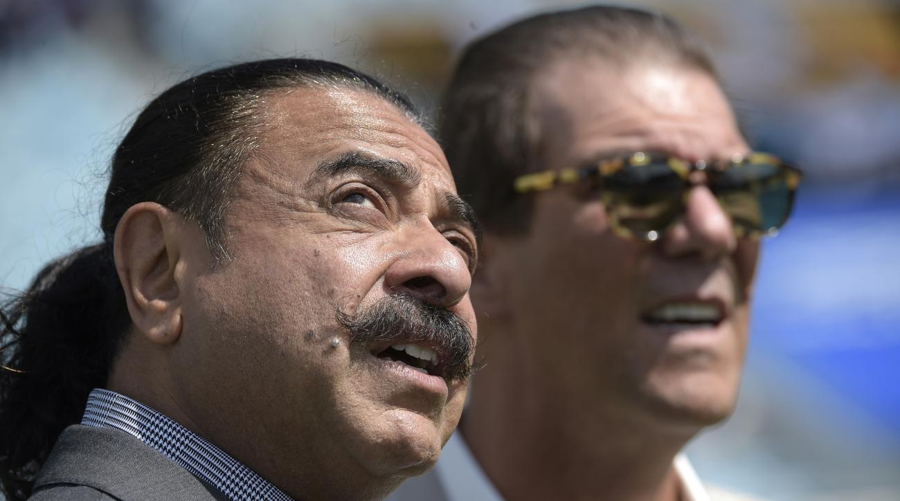 FILE - In a Sunday, Sept. 25, 2016 file photo,  Jacksonville Jaguars owner Shad Khan, left, and Baltimore Ravens owner Stephen J. Bisciotti chat before an NFL football game in Jacksonville, Fla. Khan set the tone for the Jaguars season, saying a winning r