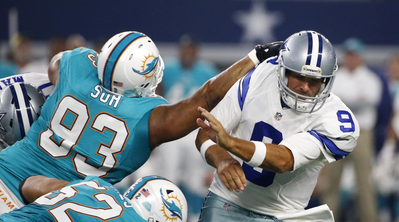 FILE- In this Aug. 19, 2016, file photo, Miami Dolphins defensive tackle Ndamukong Suh (93) and Chris Jones (52) pressure Dallas Cowboys quarterback Tony Romo (9) during the first half of an NFL preseason football game in Arlington, Texas. Drawing two blo