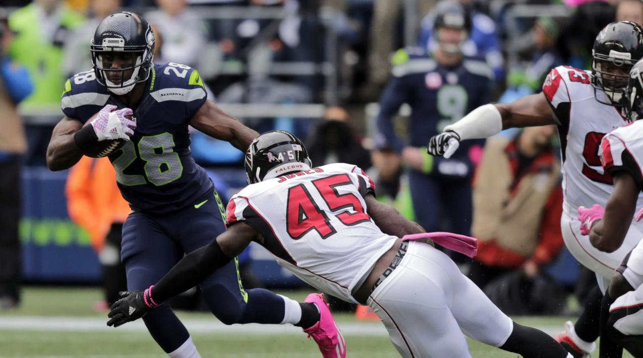 FILE - In this Oct. 16, 2016, file phot, Seattle Seahawks running back C.J. Spiller (28) is tackled by Atlanta Falcons strong middle linebacker Deion Jones (45) during the first half of an NFL football game against the Atlanta Falcons in Seattle. The New