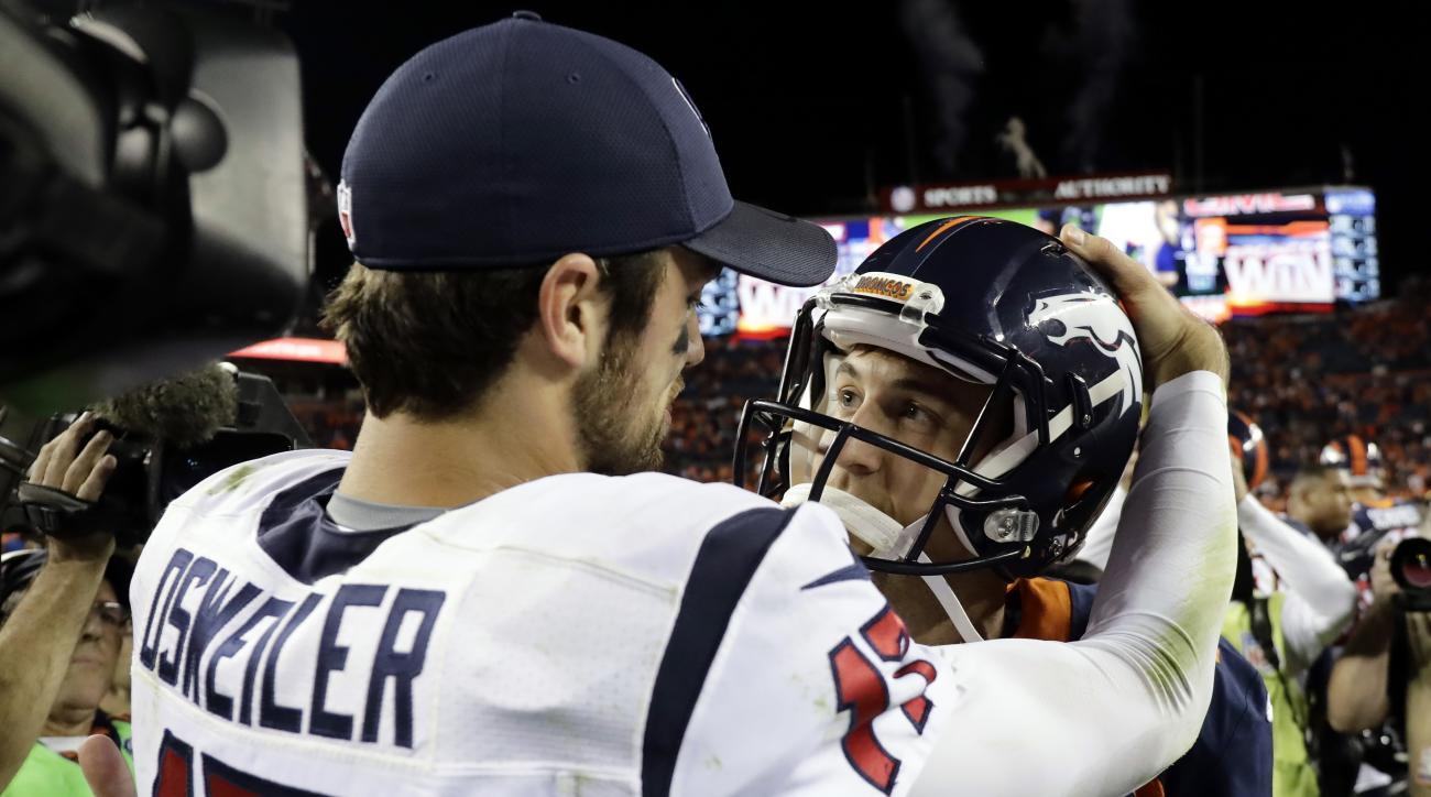 FILE - In this Oct. 24, 2016, file photo, Houston Texans quarterback Brock Osweiler (17) greets Denver Broncos quarterback Trevor Siemian (13) after an NFL football game in Denver. Osweiler's 5-2 record as Denver's starter earned him a $72 million contrac