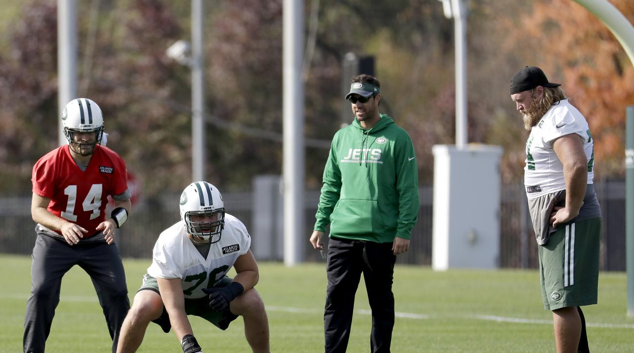 New York Jets' Ryan Fitzpatrick, left, prepares for the snap from Wesley Johnson, center, as Nick Mangold, right, looks on during NFL football practice, Wednesday, Nov. 2, 2016, in Florham Park, N.J. (AP Photo/Julio Cortez)