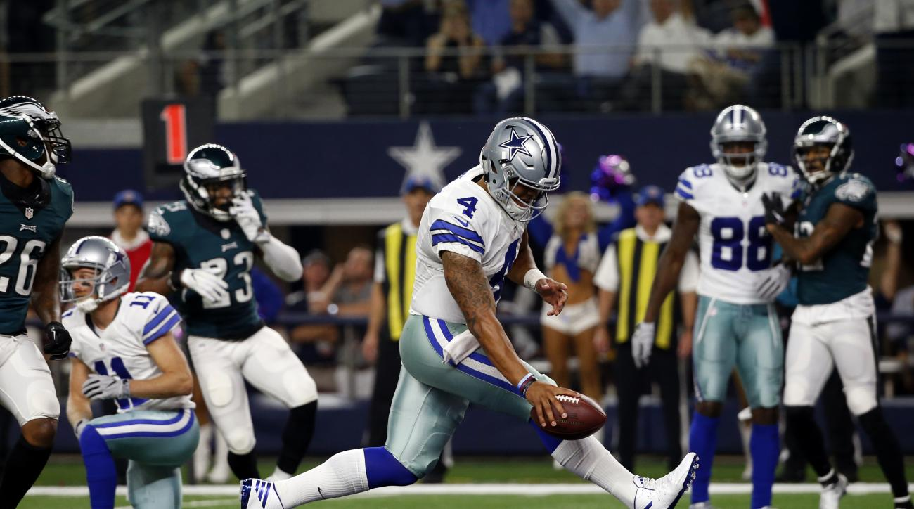 FILE - In this Sunday, Oct. 30, 2016, file photo, Dallas Cowboys quarterback Dak Prescott (4) runs the ball for a touchdown against the Philadelphia Eagles in the first half of an NFL football game in Arlington, Texas.  As Dallas rookie quarterback's winn