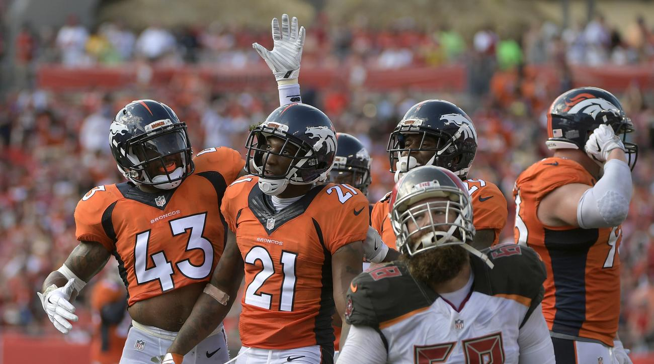 FILE - In this Oct. 2, 2016, file photo, Denver Broncos cornerback Aqib Talib (21) celebrates with strong safety T.J. Ward (43) after Talib intercepted a pass by Jameis Winston during the second quarter of an NFL football game, in Tampa, Fla. For the firs