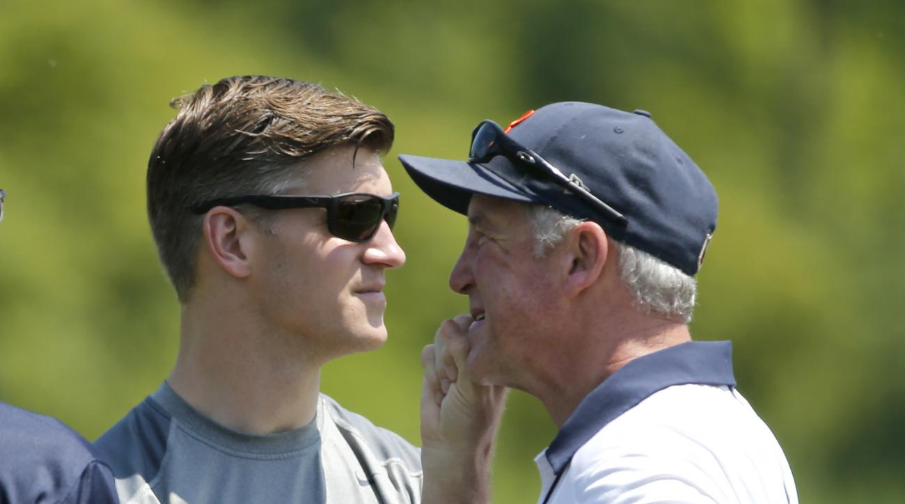 FILE - In this June 14, 2016, file photo, Chicago Bears general manager Ryan Pace, left, and head coach John Fox confer after the NFL football team's minicamp at Halas Hall in Lake Forest, Ill. Year 2 under general manager Ryan Pace and coach John Fox isn