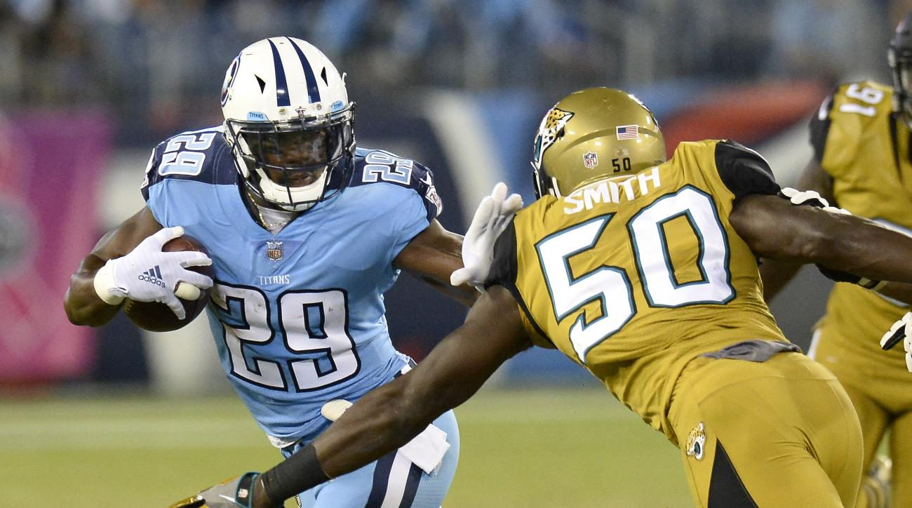 FILE -- In this Oct. 27, 2016, file photo, Tennessee Titans running back DeMarco Murray (29) tries to get past Jacksonville Jaguars linebacker Telvin Smith (50) in an NFL football game in Nashville, Tenn. Halfway through this season, Murray already has ru